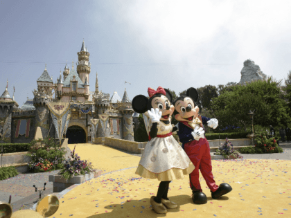 Disney characters Mickey Mouse and Minnie wave to a crowd of people in front the Sleeping Beauty Castle during the 50th anniversary of the opening of Disneyland in Anaheim, California, 17 July 2005. California's Governor Arnold Schwarzenegger, Disney CEO Michael Eisner, his designated successor Robert Iger and other personalities attended …