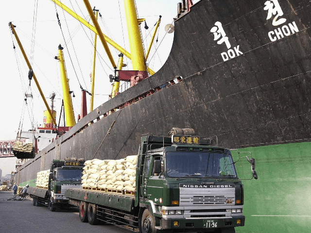 This file photo dated 18 January 2001 shows trucks at the port in Osaka stopped beside the 16,104-ton North Korean freighter Dok Chon to load bags of rice for shipment in aid to North Korea. Most North Korean ships were effectively barred from entering Japan from 01 March 2005 as …