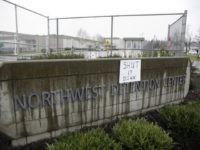"A sign that reads ""shut it down"" is pictured at the Northwest Detention Center as people attend the Peoples Tribunal Against the Detention Center event in Tacoma, Washington on February 26, 2017. / AFP / Jason Redmond (Photo credit: JASON REDMOND/AFP/Getty Images)"