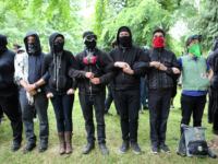 'Antifa' protesters link arms as they demonstrate at a rally on June 4, 2017 in Portland, Oregon. A protest dubbed 'Trump Free Speech' by organizers was met by a large contingent of counter-demonstrators who viewed the protest as a promotion of racism. The demonstrations come in the wake of the …