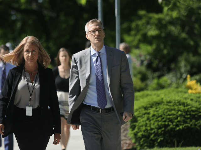 Portland mayor Ted Wheeler R arrives at Christ The King church for the funeral service of Army veteran and father of four, Ricky Best on June 5, 2017 in Milwaukie, Oregon. Best, 53, and Taliesin Namkai-Meche, 23, were stabbed to death and Micah Fletcher,21, was severely injured after they tried …