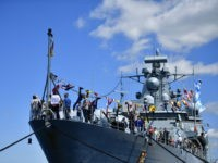 "KIEL, GERMANY - JUNE 17: Visitors walk aboard the frigate ""Mecklenburg Vorpommern"" of the German Navy during an open day of the barracks at the Kieler Woche (Kiel Week) on June 17, 2017 in Kiel, Germany. The annual Tall Ships Parade, in which many of the world's largest traditional sailing …"