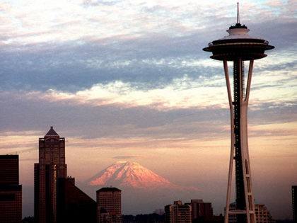 370258 05: The Seattle Space Needle is viewed during dusk with Mt. Rainier in the background May 30, 2000 in Seattle, WA. (Photo by Dan Callister/Newsmakers)