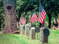 Flags on Union graves of Civil War veterans at a Wisconsin cemetery.