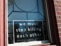 BALTIMORE, MD - FEBRUARY 03: A sign to end violence sits in a window in a neighborhood with a high murder rate on February 3, 2018 in Baltimore, Maryland. Baltimore, one of the poorest major cities in the United States, experienced 341 homicides last year, the highest per-capita rate on …