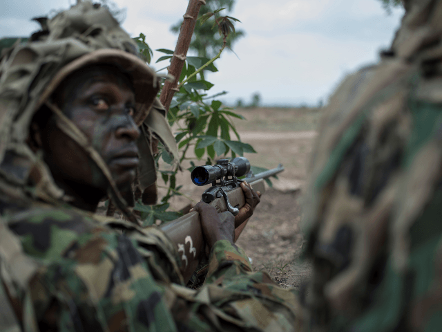 A member of the Nigerian Armed Forces Sniper Unit wearing a ghillie suit takes part in an exercise during the African Land Forces Summit (ALFS) military demonstration held at General Ao Azazi barracks in Gwagwalada on April 17, 2018. - The African Land Forces Summit (ALFS) is a weeklong seminar …