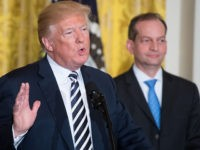 US President Donald Trump speaks alongside Secretary of Labor Alexander Acosta (R) during the National Teacher of the Year reception in the East Room of the White House in Washington, DC, May 2, 2018. (Photo by SAUL LOEB / AFP) (Photo credit should read SAUL LOEB/AFP/Getty Images)