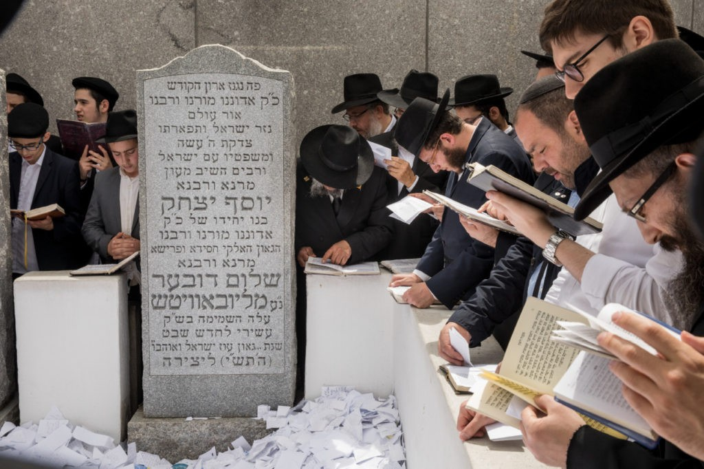 NEW YORK, NY - JUNE 15: Visitors pray at the gravesite of the Lubavitcher Rebbe, Rabbi Menachem Mendel Schneerson, at the Old Montefiore Cemetery, June 15, 2018 in the Queens borough of New York City. This year marks the 24th anniversary of the influential Jewish leader's passing. Organizers expect over 50,000 people from around the world to visit the gravesite throughout today and the weekend. (Photo by Drew Angerer/Getty Images)