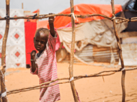A Somali boy stands next to a structure of makeshift tent at Tawakal IDP camp in Mogadishu, Somalia, on June 19, 2018. (Photo by Mohamed ABDIWAHAB / AFP) (Photo credit should read MOHAMED ABDIWAHAB/AFP/Getty Images)