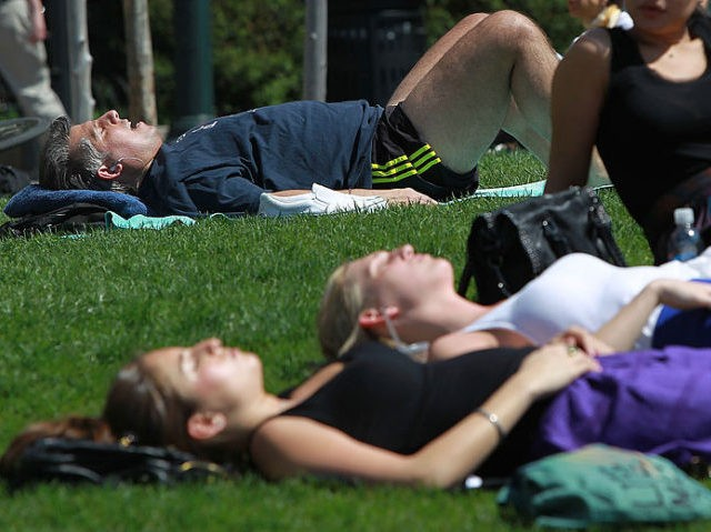 NEW YORK - APRIL 07: People sunbathe in the warm weather in Manhattan April 7, 2010 in New York City. Temperatures in the city were expected to near the daily record of 89 degrees set in 1929. (Photo by Mario Tama/Getty Images)