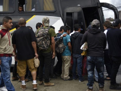 "Guatemalan immigrants deported from the United States, get on a bus as they leave the Air Force base in Guatemala City on June 22, 2018. - A group of 108 Guatemalan immigrants who tried to cross illegaly to the US under the ""zero tolerance"" migratory policy where deported. (Photo by …"