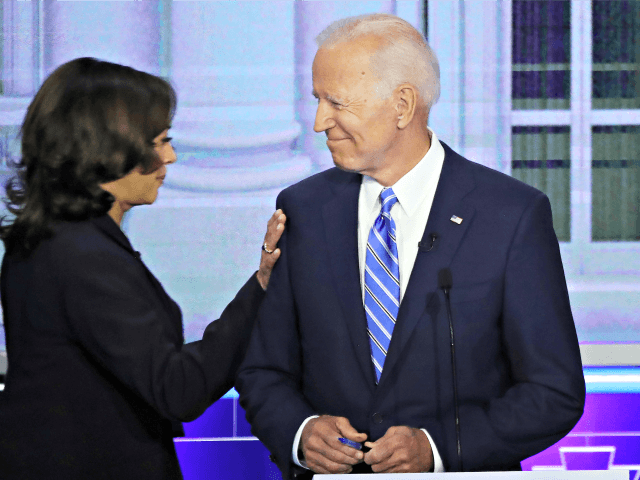 MIAMI, FLORIDA - JUNE 27: Sen. Kamala Harris (D-CA) touches former Vice President Joe Biden during the second night of the first Democratic presidential debate on June 27, 2019 in Miami, Florida. A field of 20 Democratic presidential candidates was split into two groups of 10 for the first debate …