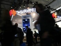 People walk by the Huawei stand at the Mobile World Congress (MWC), the world's biggest mobile fair, on February 26, 2018 in Barcelona. The Mobile World Congress is held in Barcelona from February 26 to March 1. / AFP PHOTO / Pau Barrena (Photo credit should read PAU BARRENA/AFP/Getty Images)
