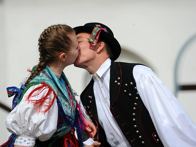 A young couple, dressed in traditional garb and members of local folklore dance group, kiss on March 28, 2012 in the village of Holloko, about 100 kms northeast of Budapest, during a media presentation of traditional Easter celebrations in the region. Holloko, a World Heritage site, will celebrate Easter next …