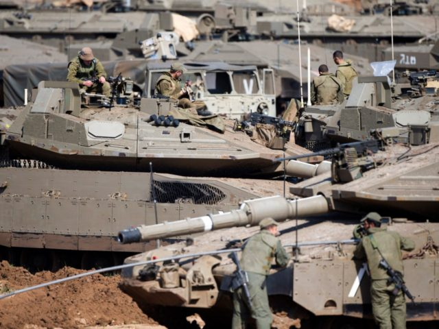 Israeli soldiers work on their tanks at a gathering area near the Israel-Gaza border, in southern Israel, Tuesday, March 26, 2019. Israeli Prime Minister Benjamin Netanyahu returned home from Washington on Tuesday, heading straight into military consultations after a night of heavy fire as Israeli aircraft bombed Gaza targets and …