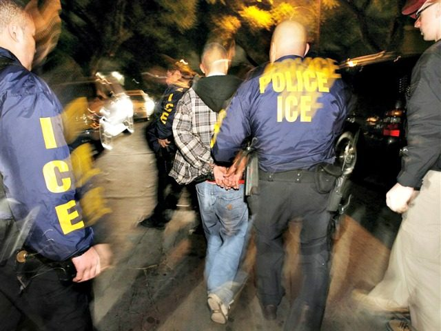 Immigration and Customs Enforcement (ICE) officers arrest a suspect during a pre-dawn raid on January 17, 2007 in Santa Ana, California.Mark Avery / AP file