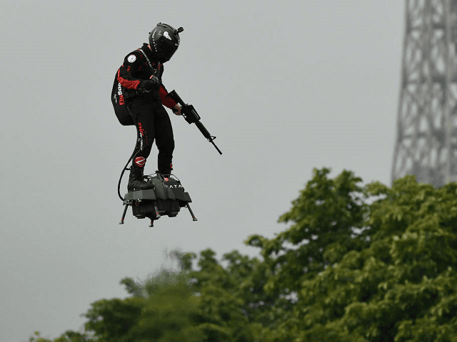 The Real Masters of the Universe? Rifle-Carrying Jetpack Man Flies Over Macron's EU Army Parade