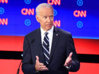 Democratic presidential hopefuls Former Vice President Joe Biden and US Senator from California Kamala Harris speak during the second round of the second Democratic primary debate of the 2020 presidential campaign season hosted by CNN at the Fox Theatre in Detroit, Michigan on July 31, 2019. (Photo by Jim WATSON …