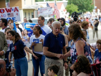 Democratic presidential candidate, former Vice President Joe Biden greets attendees during the Fourth of July parade on July 4, 2019 in Independence, Iowa. Democratic candidates for president including Joe Biden, Beto O'Rourke, Kamala Harris, Pete Buttigieg and Bernie Sanders are celebrating America's independence in Iowa. (Photo by Joshua Lott/Getty Images)
