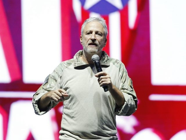 TAMPA, FLORIDA - JUNE 22: Jon Stewart speaks on stage during the opening ceremony of the 2019 Warrior Games at Amalie Arena on June 22, 2019 in Tampa, Florida. (Photo by Michael Reaves/Getty Images)