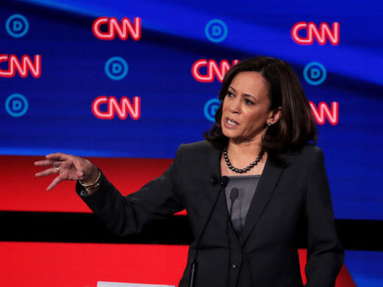 DETROIT, MICHIGAN - JULY 31: Democratic presidential candidate Sen. Kamala Harris (D-CA) (R) speaks during the Democratic Presidential Debate at the Fox Theatre July 31, 2019 in Detroit, Michigan. 20 Democratic presidential candidates were split into two groups of 10 to take part in the debate sponsored by CNN held …