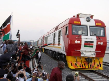 The SGR cargo train rides from the port containers depot in Mombasa, Kenya, to Nairobi, Tuesday, May 30, 2017. Kenya's president Uhuru Kenyatta opened the country's largest infrastructure project since independence, a Chinese-backed railway costing nearly $3.3 billion that eventually will link a large part of East Africa to a …