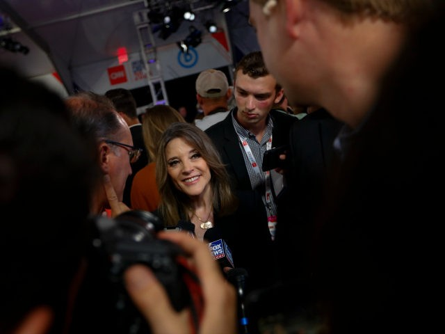 Marianne Williamson talks to reporters after the first of two Democratic presidential primary debates hosted by CNN Wednesday, July 31, 2019, in the Fox Theatre in Detroit. (AP Photo/Paul Sancya)
