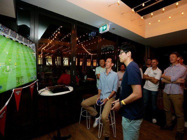 Men playing FIFA