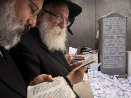 NEW YORK, NY - JUNE 15: Visitors pray at the gravesite of the Lubavitcher Rebbe, Rabbi Menachem Mendel Schneerson, at the Old Montefiore Cemetery, June 15, 2018 in the Queens borough of New York City. This year marks the 24th anniversary of the influential Jewish leader's passing. Organizers expect over …