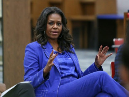 "Former first lady Michelle Obama speaks with students at her alma mater, Whitney M. Young Magnet High School, on Chicago's West Side, Monday, Nov. 12, 2018, a day before the launch of a book tour to promote her memoir, ""Becoming."" (AP Photo/Teresa Crawford)"
