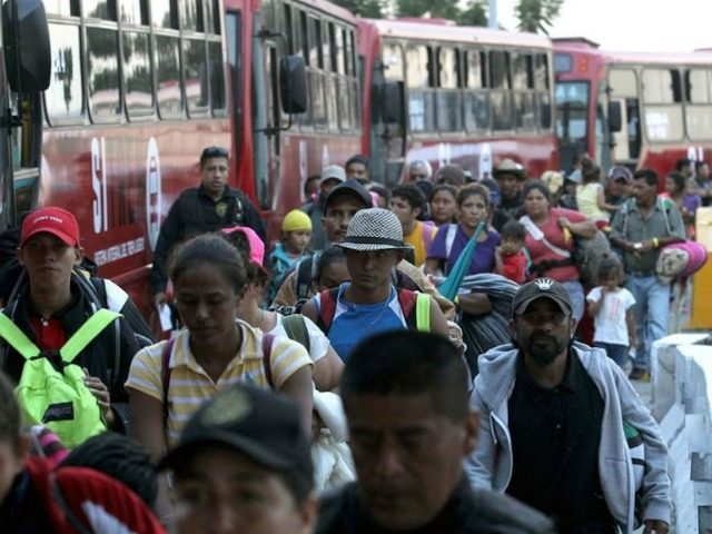 Migrants Board busses to US