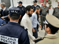 A picture taken on May 2, 2019 shows suspects, in the murder of two Scandinavian hikers, arriving for their trial at a Moroccan court in Sale near the capital Rabat. - A Moroccan court adjourned for two weeks the trial of two dozen suspects accused of the murder of two …