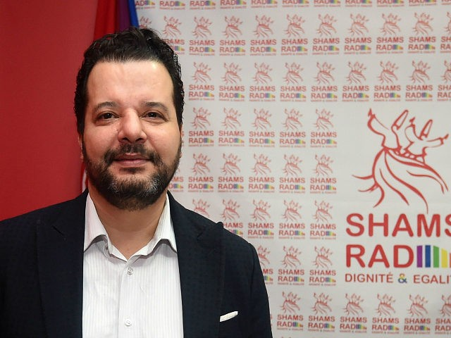 "Tunisian lawyer Mounir Baatour (L), president of the association ""Shams"" which supports the depenalization of homosexuality in Tunisia and president of ""Shams Radio"", the first LGBT radio in the Arab region, poses in the studio as he arrives for the opening of the radio station on December 18, 2017 in …"