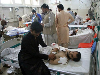 A wounded man receives treatment in a hospital after a suicide attack on the outskirts of Nangarhar province east of Kabul, Afghanistan, Friday, July 12, 2019. A 13-year old suicide bomber blew himself up at a wedding early Friday in eastern Afghanistan's Nangarhar province, killing five people and injuring 11 …