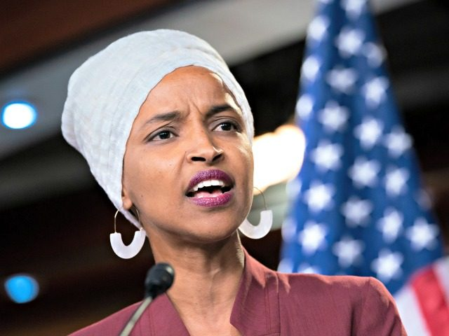 """Rep. Ilhan Omar, D-Minn., respond to remarks by President Donald Trump after his call for the four Democratic congresswomen to go back to their """"broken"""" countries, during a news conference at the Capitol in Washington, Monday, July 15, 2019. All are American citizens and three of the four were born …"""