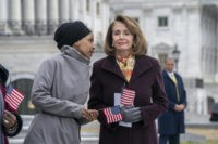 "Rep. Ilhan Omar, D-Minn., left, whispers to Speaker of the House Nancy Pelosi, D-Calif., as Democrats rally outside the Capitol ahead of passage of H.R. 1, ""The For the People Act,"" a bill which aims to expand voting rights and strengthen ethics rules, in Washington, Friday, March 8, 2019. The …"