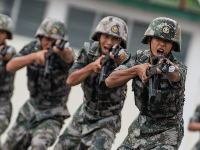 HONG KONG, HONG KONG - June 30: Members of the People's Liberation Army (PLA) perform drills during a demonstration at an open day at the Shek Kong Barracks on June 30, 2018 in Hong Kong, Hong Kong. Hong Kong will mark 21 years since its return to Chinese sovereignty from …