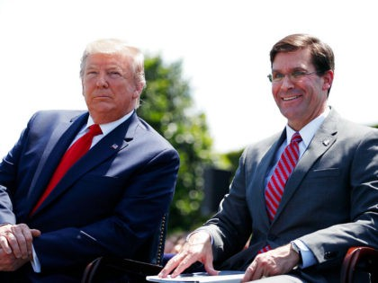 President Donald Trump, left, sits with Secretary of Defense Mark Esper, during a full honors welcoming ceremony for Esper at the Pentagon, Thursday, July 25, 2019, in Washington. (AP Photo/Alex Brandon)