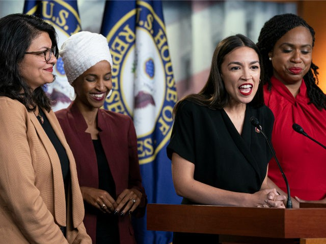 U.S. Rep. Alexandria Ocasio-Cortez, D-N.Y., speaks as, from left, Rep. Rashida Tlaib, D-Mich., Rep. Ilhan Omar, D-Minn., and Rep. Ayanna Pressley, D-Mass., listen during a news conference at the Capitol in Washington, Monday, July 15, 2019. President Donald Trump on Monday intensified his incendiary comments about the four Democratic congresswomen …
