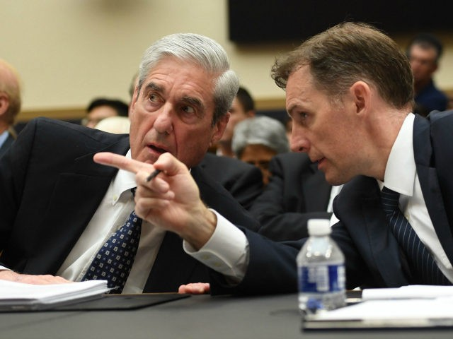 Former Deputy Special Counsel Aaron Zebley (R) confers with former Special Prosecutor Robert Mueller during a hearing before Congress on July 24, 2019, in Washington, DC. - Three months after releasing the final report on his probe into the 2016 election, much of the American public remains unclear about the …