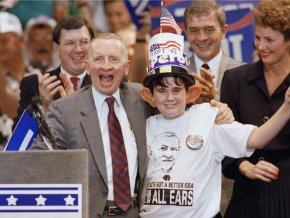 Ross Perot shares a laugh with 12-year-old supporter Kevin Grace, of Port Richey, Fla., following a rally in Tampa on Saturday, Oct. 31, 1992. Perot waved Grace onto the stage after spotting the large fake ears Grace was wearing. (AP Photo/Kathy Willens)