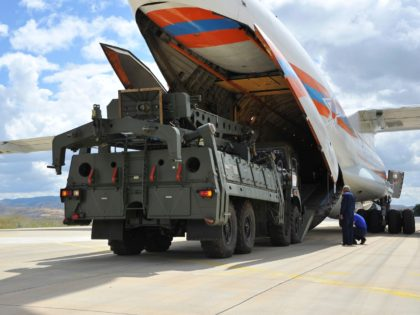 Military vehicles and equipment, parts of the S-400 air defense systems, are unloaded from a Russian transport aircraft, at Murted military airport in Ankara, Turkey, Friday, July 12, 2019. The first shipment of a Russian missile defense system has arrived in Turkey, the Turkish Defense Ministry said Friday, moving the …