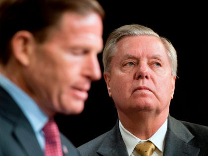 US Senator Lindsey Graham (R), R-South Carolina, and US Senator Richard Blumenthal (L), D-Connecticut, explain Extreme Risk Protection Orders on Capitol Hill in Washington, DC, on March 8, 2018. / AFP PHOTO / JIM WATSON (Photo credit should read JIM WATSON/AFP/Getty Images)