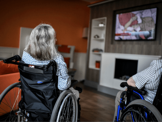 Elderlies residents sit on wheelchairs watch the television on July 5, 2018, in an establishment of accommodation for dependent elderly (EHPAD) in Paris. (Photo by STEPHANE DE SAKUTIN / AFP) (Photo credit should read STEPHANE DE SAKUTIN/AFP/Getty Images)