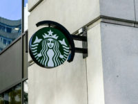 A Starbucks logo hangs over a store entrance in Washington, DC June 11, 2019. (Photo by EVA HAMBACH / AFP) (Photo credit should read EVA HAMBACH/AFP/Getty Images)