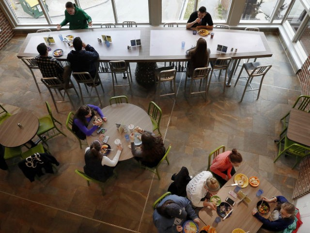 Students at the University of New Hampshire have lunch at the new $17,000 custom-made chef's table, top, at the campus dining hall Friday April 29, 2016 in Durham, N.H. The University of New Hampshire now acknowledges that spending $17,000 on a custom-made chef's table with LED lights for the campus …
