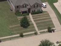 Cameron James, 17, of Haslet, Texas, mowed a giant American flag into the front lawn of his family's home Monday. It was in honor of his friend, Army Pfc. Kevin Christian, who died.