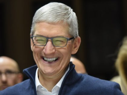 Tim Cook CEO of Apple laughing