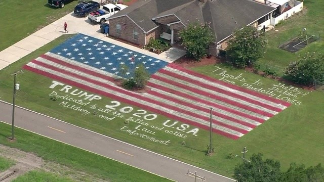 Jason Stanley of Plant City, Florida said he used 15 gallons of paint to create a massive American flag display on his lawn (Fox 32).