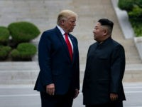 US President Donald Trump and North Korea's leader Kim Jong-un stand on North Korean soil while walking to South Korea in the Demilitarized Zone(DMZ) on June 30, 2019, in Panmunjom, Korea. (Photo by Brendan Smialowski / AFP) (Photo credit should read BRENDAN SMIALOWSKI/AFP/Getty Images)